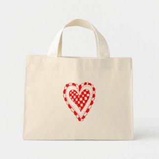 Diseño con volantes de los bordes del corazón rojo bolsas