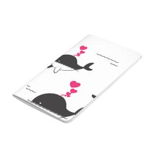 Diseño de la ballena negra y blanca con los cuadernos grapados