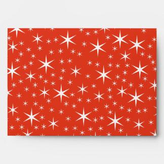 Diseño de la chuchería del navidad en negro, rojo  sobres