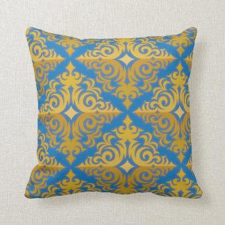Diseño de la diadema del azul y del oro cojín