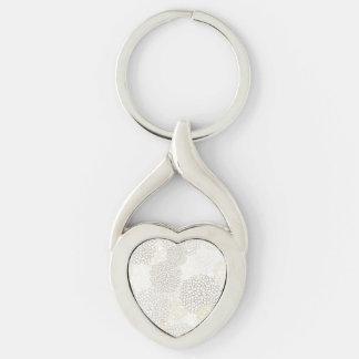 Diseño de la explosión de la arcilla y de la flor llavero plateado en forma de corazón