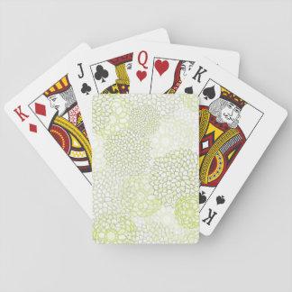 Diseño de la explosión del verde de guisante y barajas de cartas