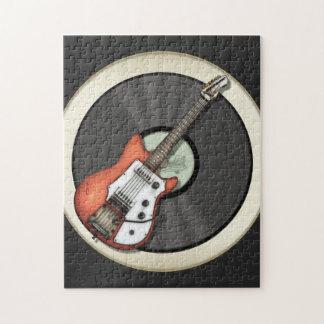 Diseño de la guitarra y del disco de vinilo del vi rompecabeza