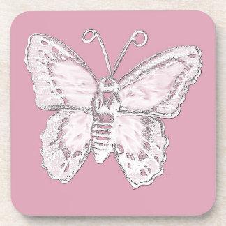 Diseño de la mariposa del arte en blanco en pálido posavasos