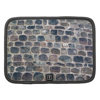 Diseño de la pared de piedras de pavimentación organizador