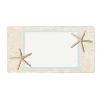 Diseño de las estrellas de mar y de la arena etiqueta de envío
