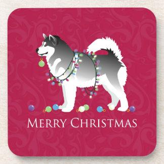 Diseño de las Felices Navidad del perro del Posavaso