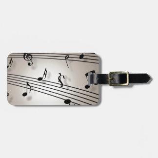 Diseño de las notas musicales etiqueta de maleta