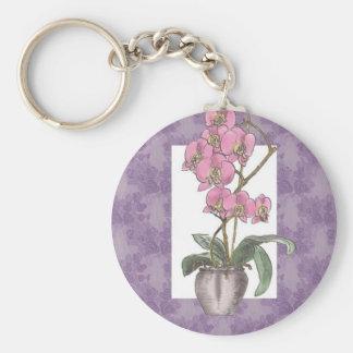 Diseño decorativo de la orquídea llavero redondo tipo pin