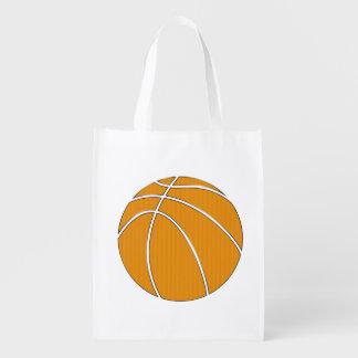Diseño del baloncesto en naranja tradicional y bolsas para la compra