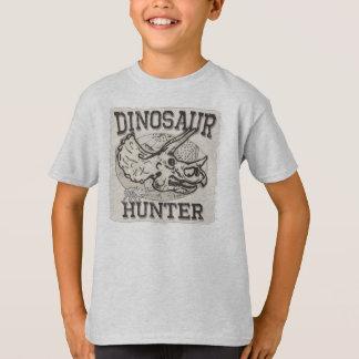 Diseño del cazador del dinosaurio por los estudios playera