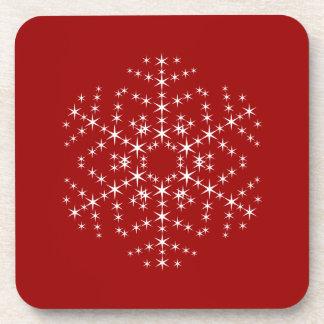 Diseño del copo de nieve en rojo oscuro y blanco posavaso