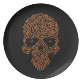 Diseño del cráneo de las flores y de las vides de plato de comida