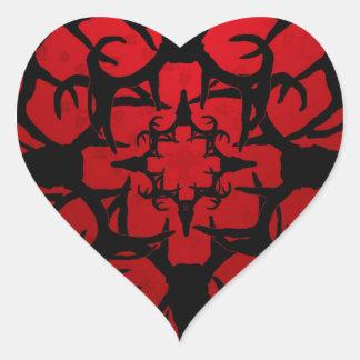 Diseño del cráneo de los ciervos en negro y rojo pegatina en forma de corazón