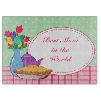 Diseño del día de madre con la flor, la empanada y tablas de cortar