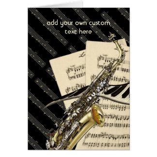 Diseño del saxofón y de la música del piano tarjeta de felicitación