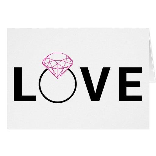 Diseño del texto del amor con el anillo de diamant felicitacion