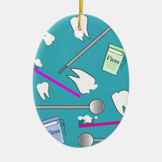 Diseño dental de las herramientas de la profesión adorno navideño ovalado de cerámica