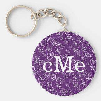 Diseño espiral en tela púrpura llavero