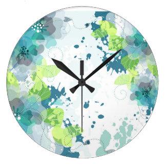 Diseño floral azul y verde abstracto reloj