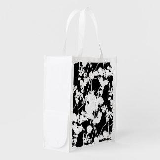 Diseño floral del chapoteo bolsa de la compra