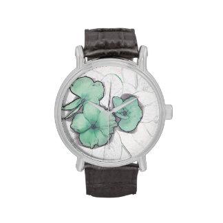 diseño floral del molinillo de viento de la flor v relojes