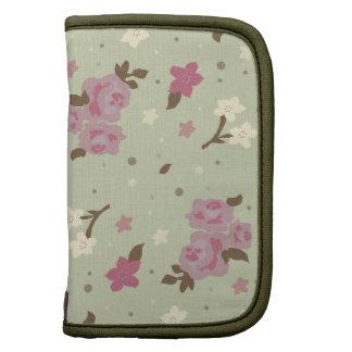 Diseño floral rosado y verde elegante lamentable c planificadores