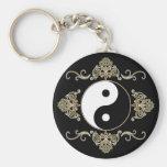 Diseño hermoso de Yin Yang en negro y oro Llaveros