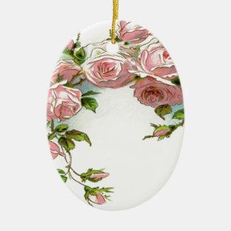 Diseño hermoso del rosa adorno navideño ovalado de cerámica