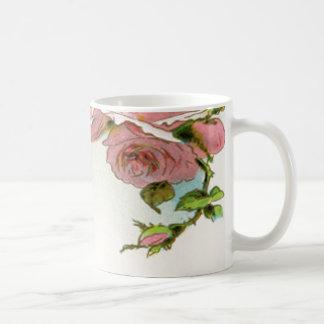Diseño hermoso del rosa taza