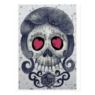 Diseño lindo del cráneo y del corazón del azúcar postal