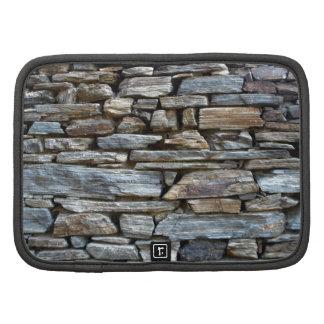 Diseño natural de la pared de piedras planificador