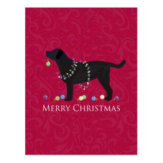 Diseño negro de las Felices Navidad del Postales