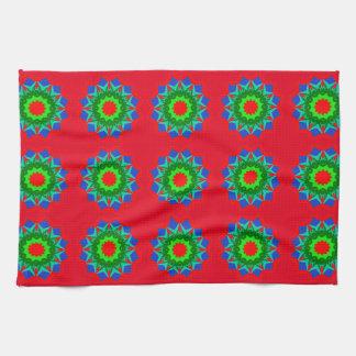 Diseño ornamental con rojo en la mano/la toalla de