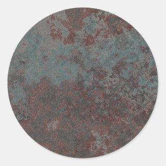 Diseño oxidado del metal etiqueta redonda