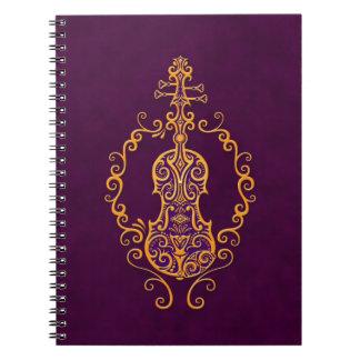 Diseño púrpura de oro complejo del violín libros de apuntes con espiral
