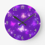 Diseño púrpura violeta de las mariposas ligeras de reloj