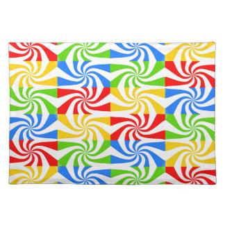 Diseño rojo, azul, verde, amarillo del bastón de manteles individuales