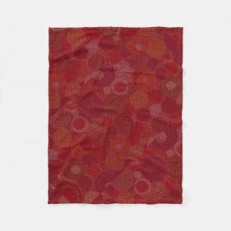 Diseño rojo circular en la manta del bebé manta de forro polar