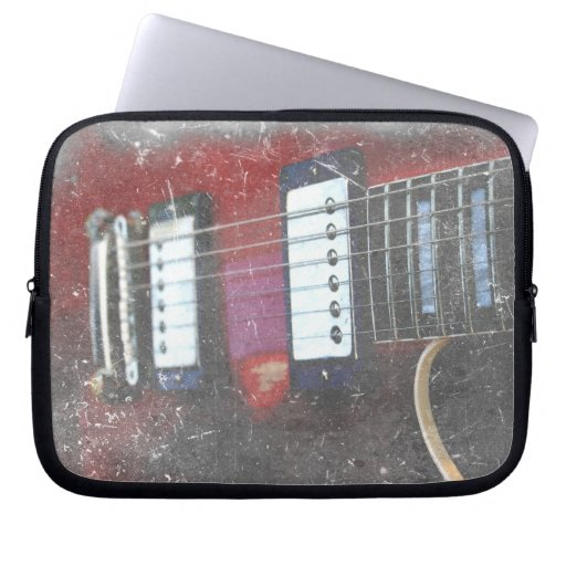 diseño rojo de la música del grunge del puente de  fundas computadoras