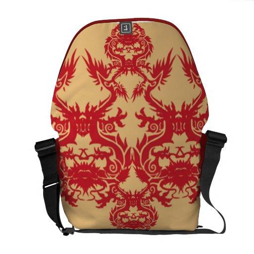 Diseño rojo del dragón en la bolsa de mensajero de bolsas messenger