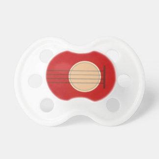Diseño rojo gráfico del instrumento musical de la  chupete
