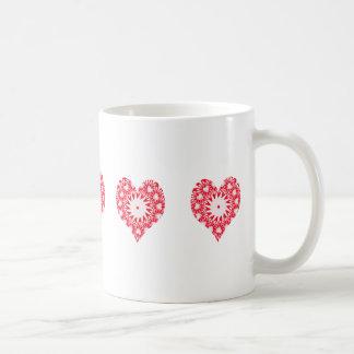 Diseño rojo y blanco del caleidoscopio de los taza de café