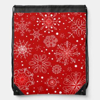 Diseño rojo y blanco del navidad del copo de nieve mochilas