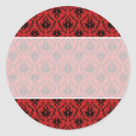 Diseño rojo y negro del damasco etiqueta redonda