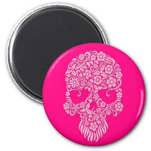 Diseño rosado del cráneo de las flores y de las vi iman