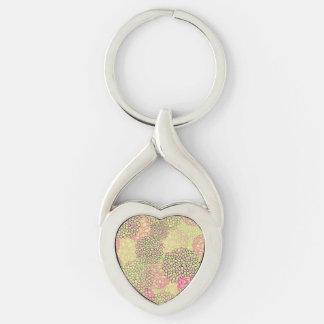 Diseño rosado y amarillo de la explosión de la llavero plateado en forma de corazón