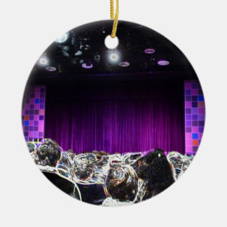 Diseño solarized etapa púrpura del teatro adorno navideño redondo de cerámica