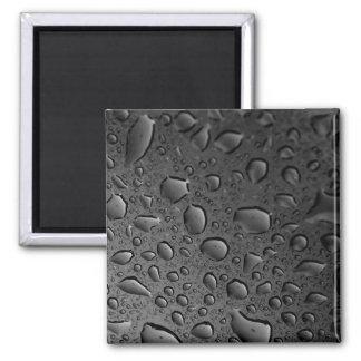 Diseño texturizado de las gotitas de agua del negr imán cuadrado