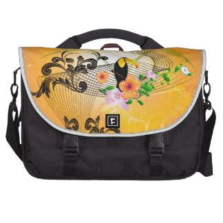 Diseño tropical con toucan bolsas de portatil